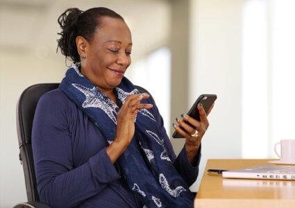 Senior Using Cell Phone